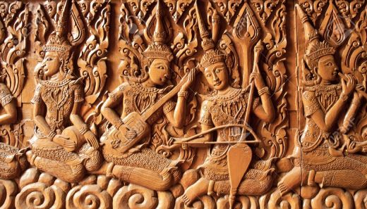 13907151-carving-angle-are-playing-thai-music-buddhist-temple-thailand-Stock-Photo